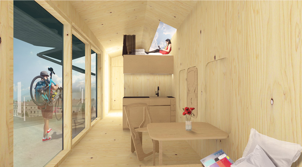 The interior of a CABIN SPACEY including a bathroom, bed, and kitchenette. | © CABIN SPACEY