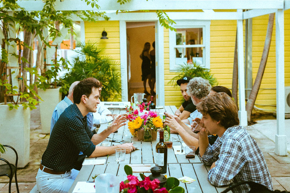 Communal living on the patio of Roam Miami