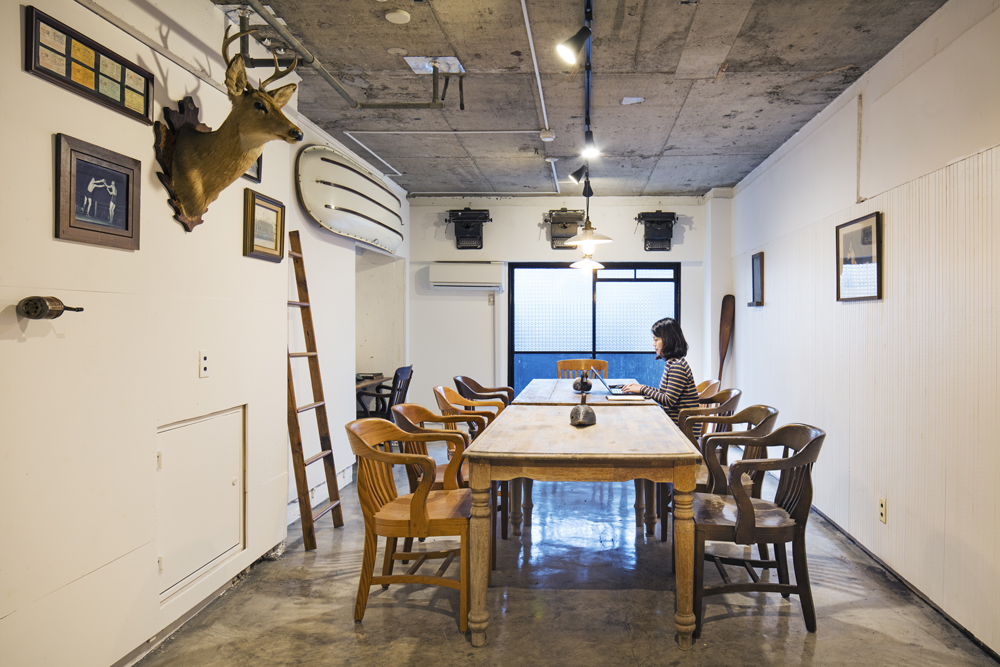 Working underneath antlers: the conference room of Roam Tokyo.