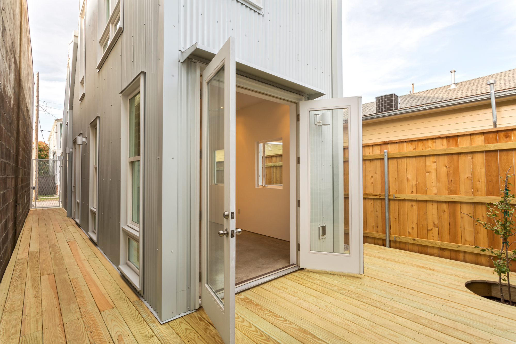 The elevated deck behind the Starter Home* in New Orleans by architect OJT, Office of Jonathan Tate